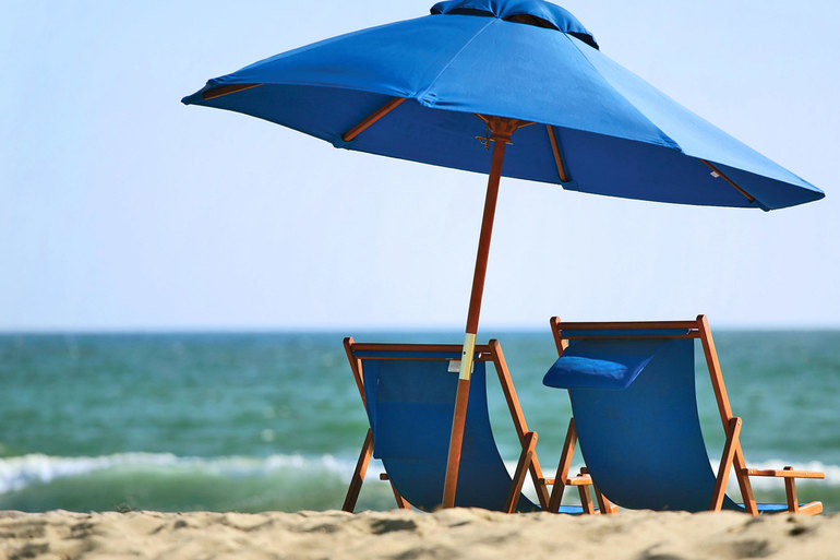 Normal_blue-beach-umbrellas-background